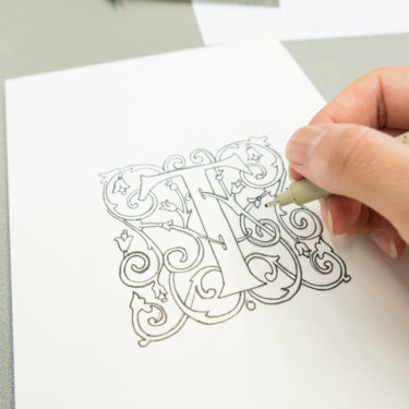 Going over the letter with pen